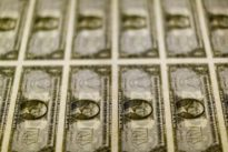 Dollar slips from two-week high, focus on BOJ and Fed meetings