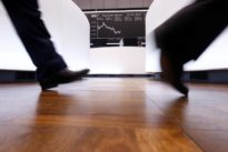 Global stocks top 2016 gains, dollar up before Fed minutes