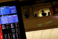 Stocks up, dollar firm as U.S. jobs data set to clear path for higher rates