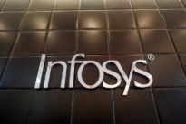 India`s Infosys says reassessing long-term goals due to tougher market