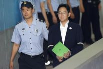 Samsung scion Lee fights back tears as prosecutors seek 12 years` jail
