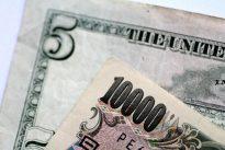 Dollar trades below 12-week high vs. yen as North Korea fears weigh