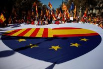 Hundreds of thousands march for unified Spain, poll shows depths of division