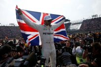 Hamilton takes fourth title despite collision