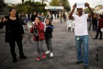 Workers at Israel's Teva Pharm block roads, continue protest over job