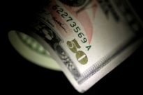 Dollar edges up, euro slumps after Catalan vote