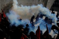 Greek police fire teargas at protesters after Athens march
