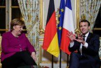 Merkel and Macron play up euro zone reform plans