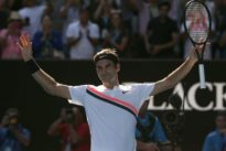 Federer makes light of day shift to ease into last eight