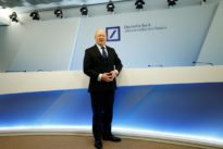 Deutsche Bank lowers 2018 cost-cutting aim on delayed divestitures