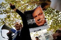 Israeli protesters urge Netanyahu to step down over bribery…
