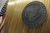SEC investigates Overstock token sale, shares slide