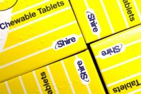 Shire sells cancer drugs to Servier for $2.4 billion as Takeda circles