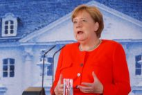 Euro reforms will be backed by German coalition, lawmakers: Merkel