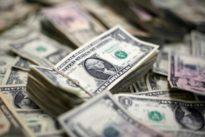 Dollar holds near 1-week lows as trade war concerns rise