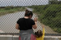 U.S. government says it will detain migrant children with parents