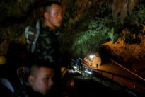 Searching for missing boys, Thai divers grope way through flooded cave