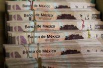 Mexico peso wobbles after leftist Lopez Obrador's big win