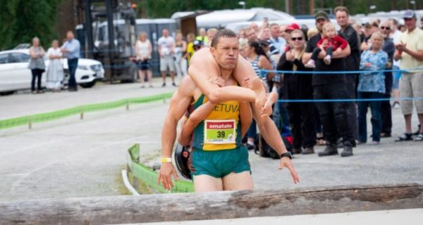 Lithuanian couple win world wife-carrying championship title in…