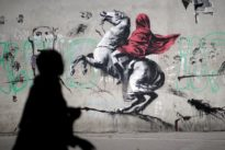 Banksy's subversive art draws tourists and locals in Paris