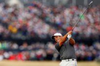 Golf: Molinari plots course through the mayhem to win Open