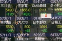 Asian shares rise after Powell speech, stronger yuan lifts China