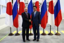 Japan's Abe says wants to discuss peace treaty with Putin