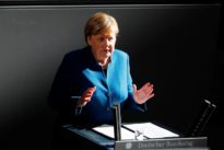 Merkel calls for stable euro zone budgets in warning shot to Italy