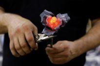 Israeli artist beats Gaza rockets into Hanukkah lamps