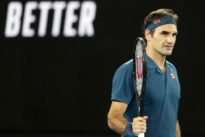 Federer serves up dominant first-round win against Istomin