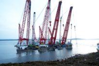 Crane ships begin raising Norwegian navy ship damaged by oil tanker