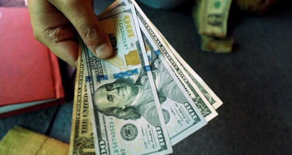 Dollar on back foot after soft data fans bets on dovish Fed