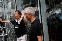 Hong Kong protesters ram legislature as thousands rally to mark…