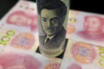 Yen rises, yuan pares losses as Sino-U.S. tariffs kick in