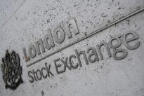 Stocks sink on dismal euro zone data, dollar gains