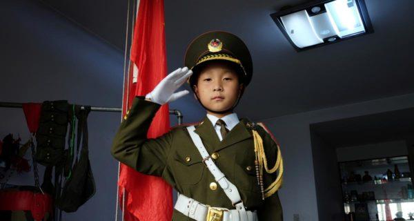 China's 'national flag baby' raises flag, captivates millions