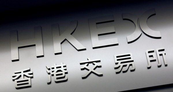Police shooting rattles Hong Kong markets, investors count on Alibaba listing