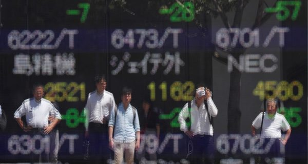 Shares grind towards record high as China trims key rate
