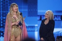 Taylor Swift puts rancor aside, smashes all-time American Music Award record