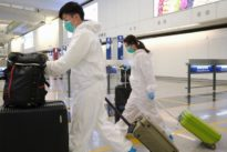 Hong Kong activates only a third of virus quarantine wristbands as thousands return home