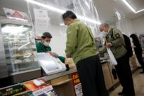 With plastic sheets, Japan's convenience stores target social distancing