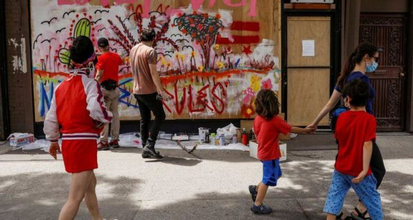 Artists paint New York shops boarded up after looting to raise hope