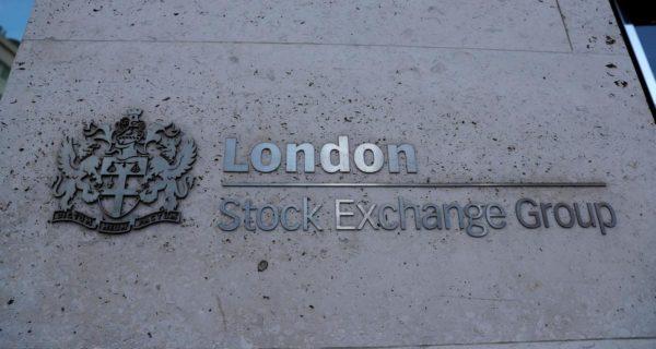 Global stocks shrug off fresh virus wave fears, dollar slips