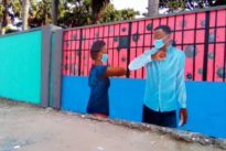 Writing on the wall: Congolese murals counter COVID-19 denial