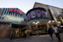 AMC reaches agreement with bondholders to reduce debt by up to $630 million