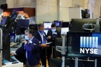 Equities hit five-month peak, bonds dip, as earnings season starts