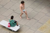 Man parades down Oxford Street wearing nothing but mask