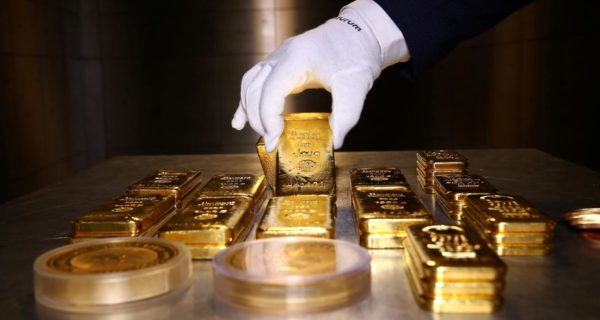 Gold roars to record high, dollar dives again